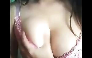 Desi indian Girl Kajal playing around her boobs