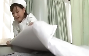 Sexy japanese nurse giving specimen a handjob
