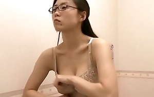 Election lady trying out bra after work