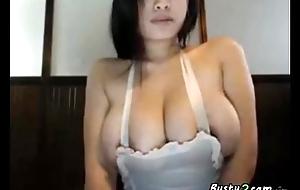 Busty asian masturbating