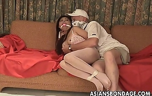 Asian slut is getting roped up with an increment of treated to a bdsm session