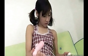 A youthful Oriental girl is playing round a sex toy, lickin from http://alljapanese.net