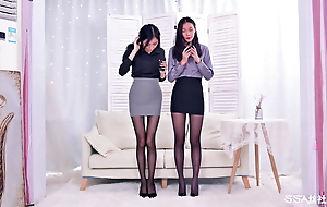 Secretary in office outfit, talks about pantyhose