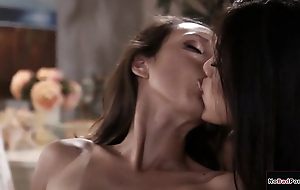 Busty Asian and her gf share and lick a petite European babe